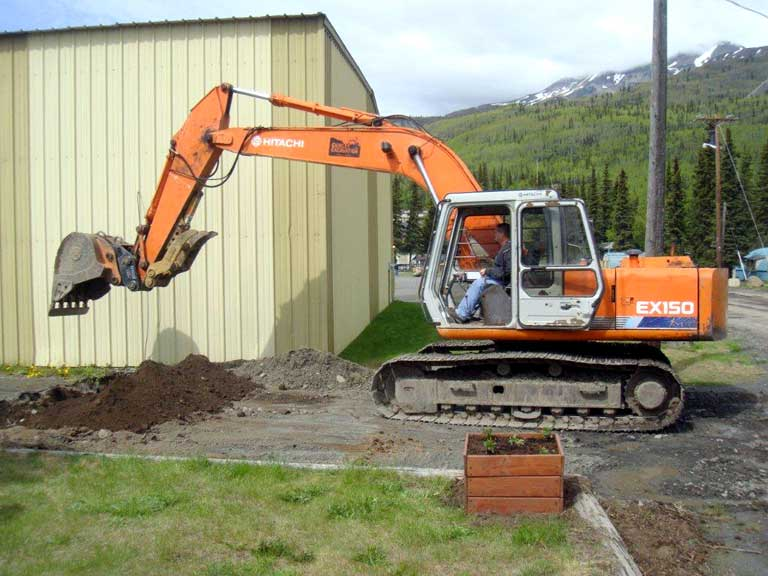 Alaska Victory Camp backhoe